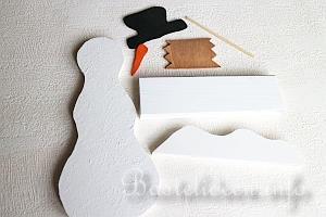 basteln mit holz - weihnachten - laubsaegearbeit - schneemann