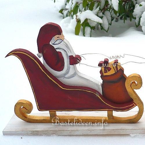 basteln mit holz weihnachtsmann rentiere und schlitten. Black Bedroom Furniture Sets. Home Design Ideas