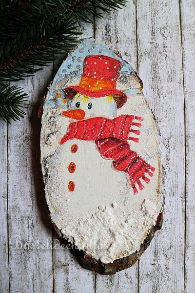Weihnachtsbasteln baumscheibe winterlicher schneemann for Dekoration schneemann